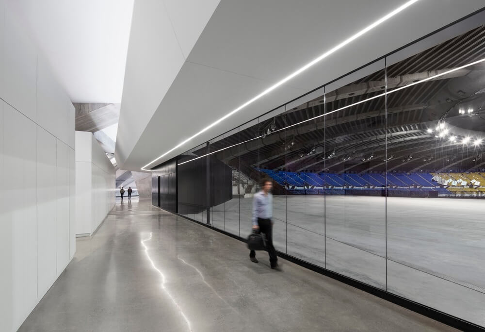 An internal corridor with a view of the stadium interior