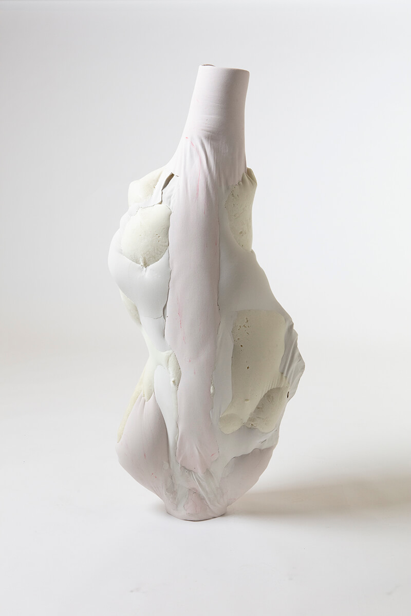 A profile view of a Julia Olanders sculpture, resembling the contours of a human body