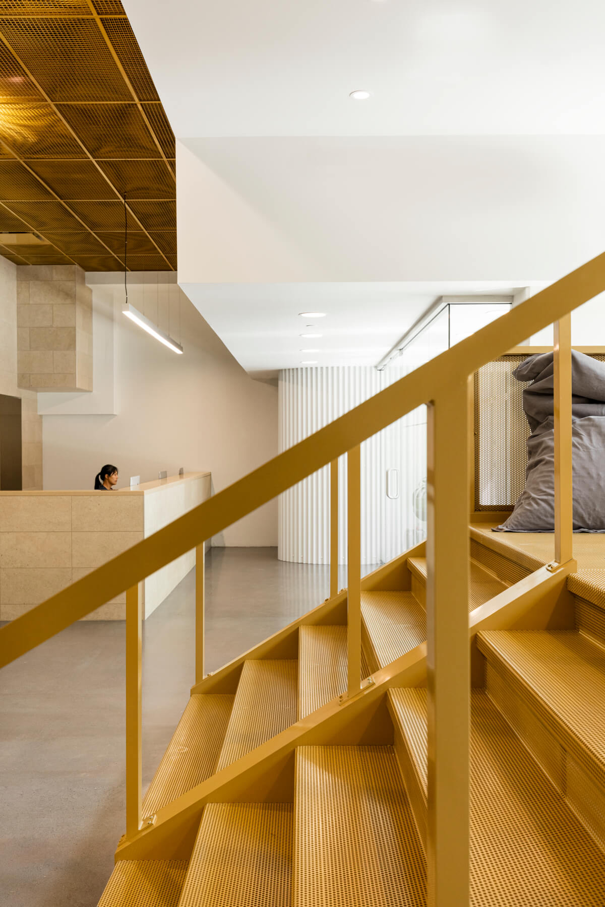 Reception and golden staircase at Go Orthodontistes office, designed by Natasha Thorpe