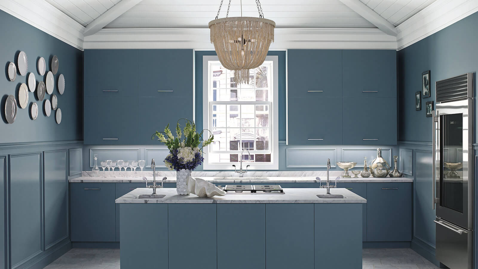 Open concept kitchen with island, Benjamin Moore paint on walls in a navy grey colour
