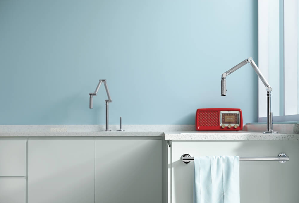 Closer shot of faucets with light blue Benjamin Moore paint on wall