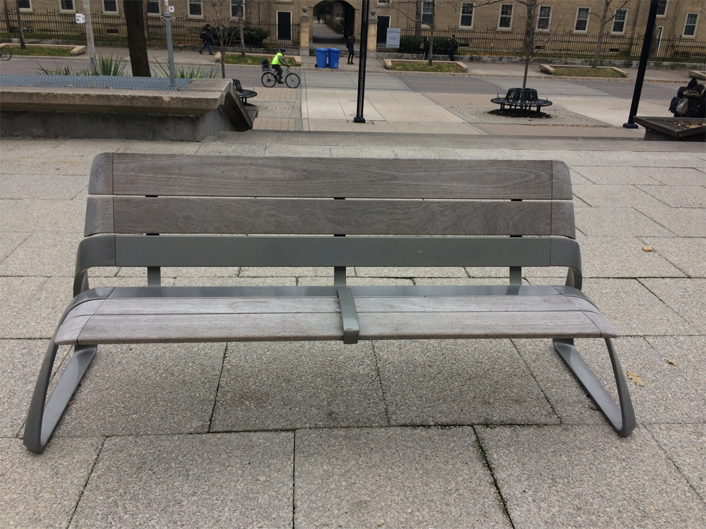 Bench with low separator bar in centre of the seat