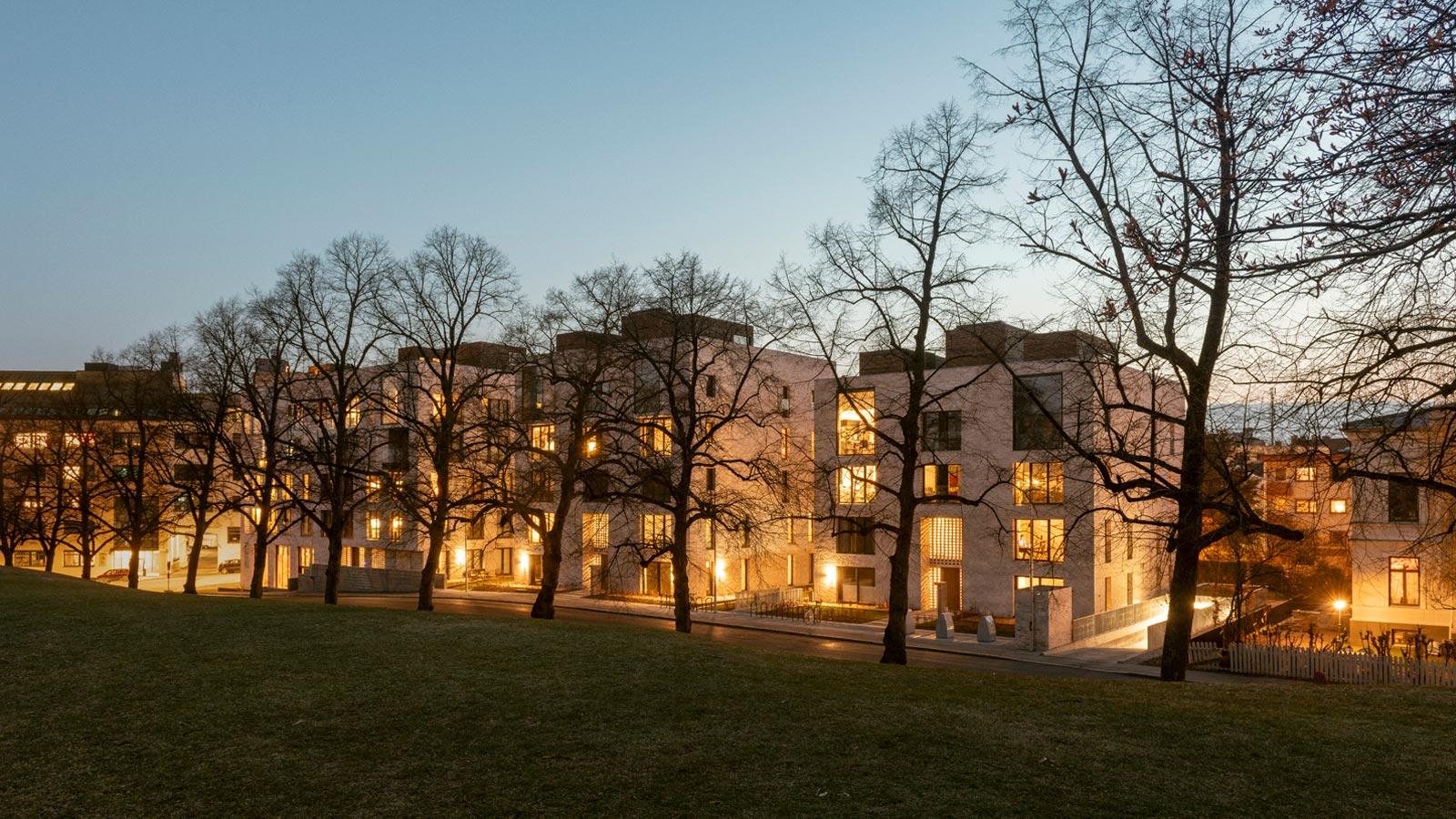 Pilestredet Apartments exterior photograph in the evening