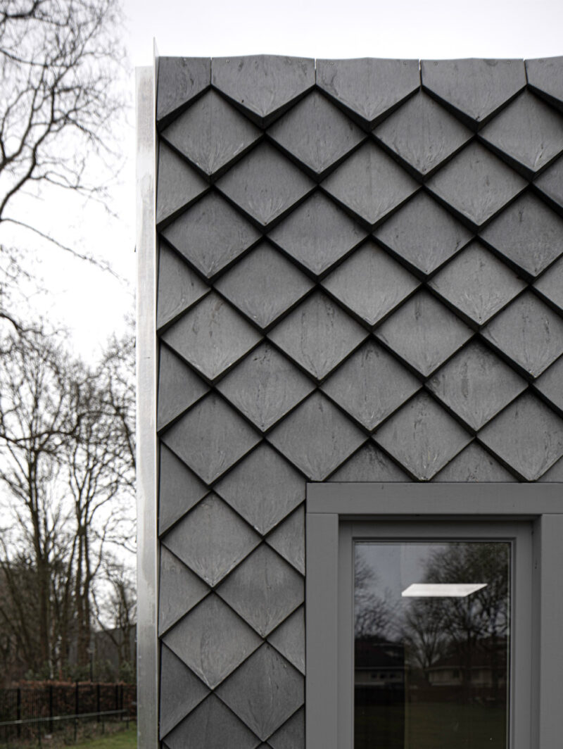 Shingles made of recycled materials on a pavilion in the Netherlands, closer view