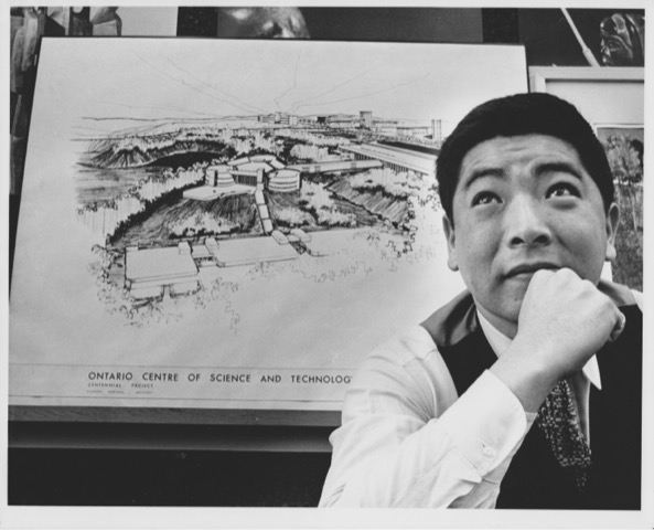 Raymond Moriyama with drawing of the Ontario Centre of Science and Technology behind him, black and white