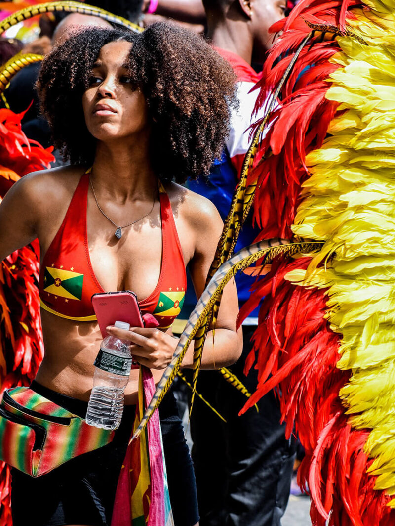 A person wearing Carnival attire dances during a parade.