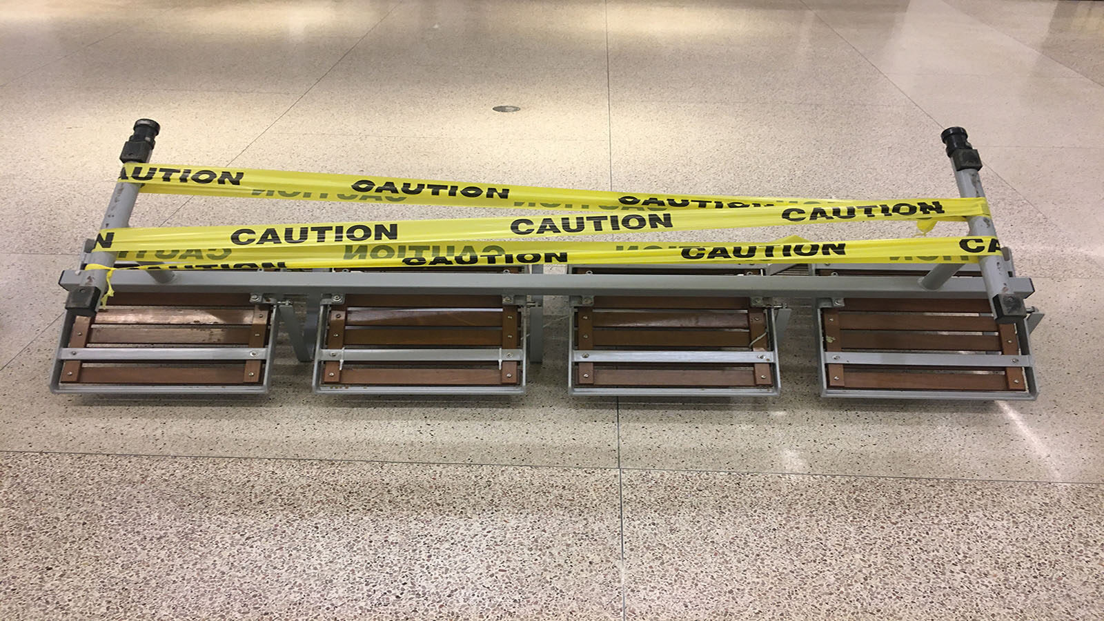 Union Station benches folded on the floor and wrapped in caution tape.