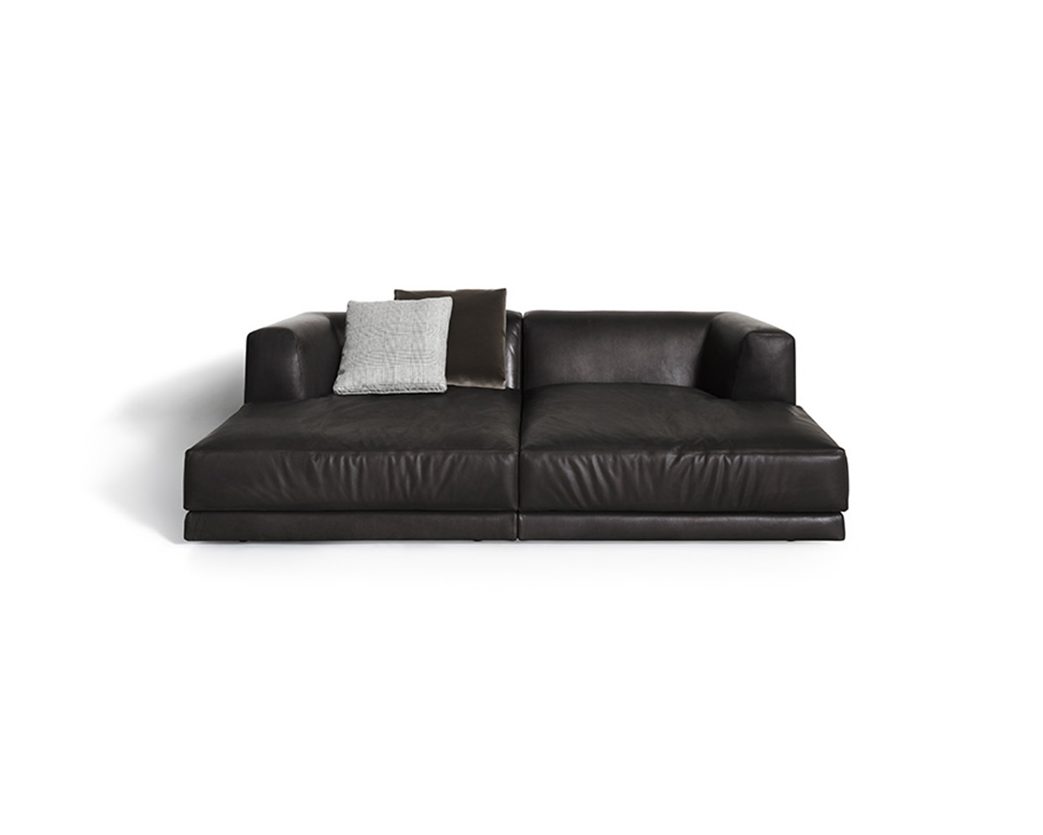 White Alberese loveseat in black leather with throw pillows in various neutral colours on white background