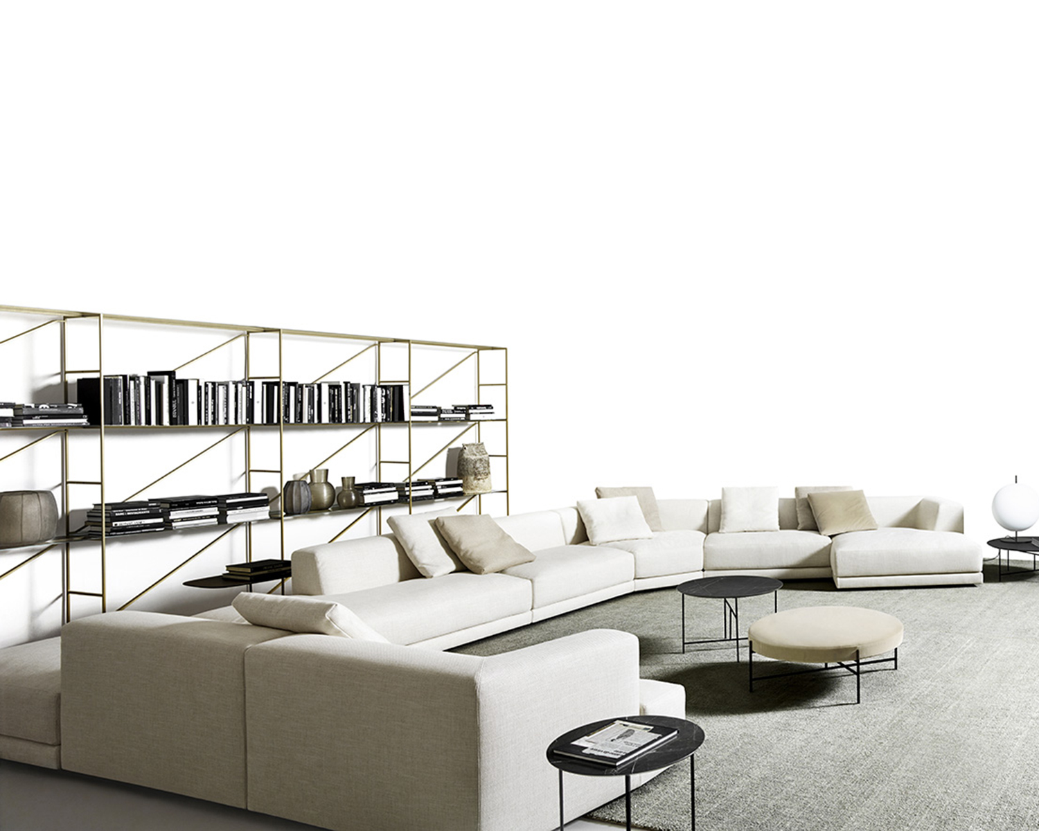 White Alberese modular sectional with throw pillows in various neutral colours, seen from the side
