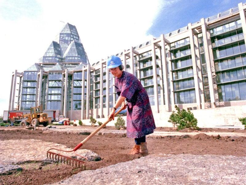 Cornelia Oberlander raking dirt at National Gallery site in 1988