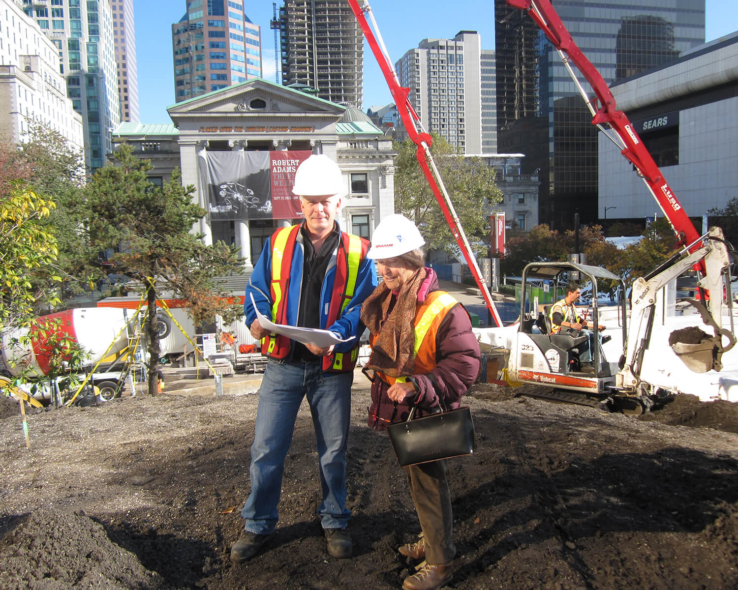 Cornelia Oberlander wearing construction gear at Robson Square in 2011