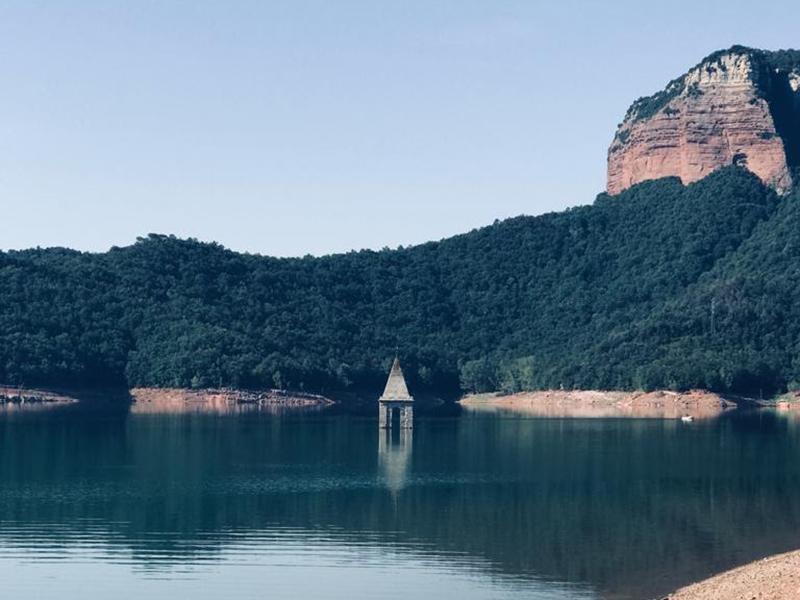 View of church steeple emerging from the reservoir in El Panta De Sau