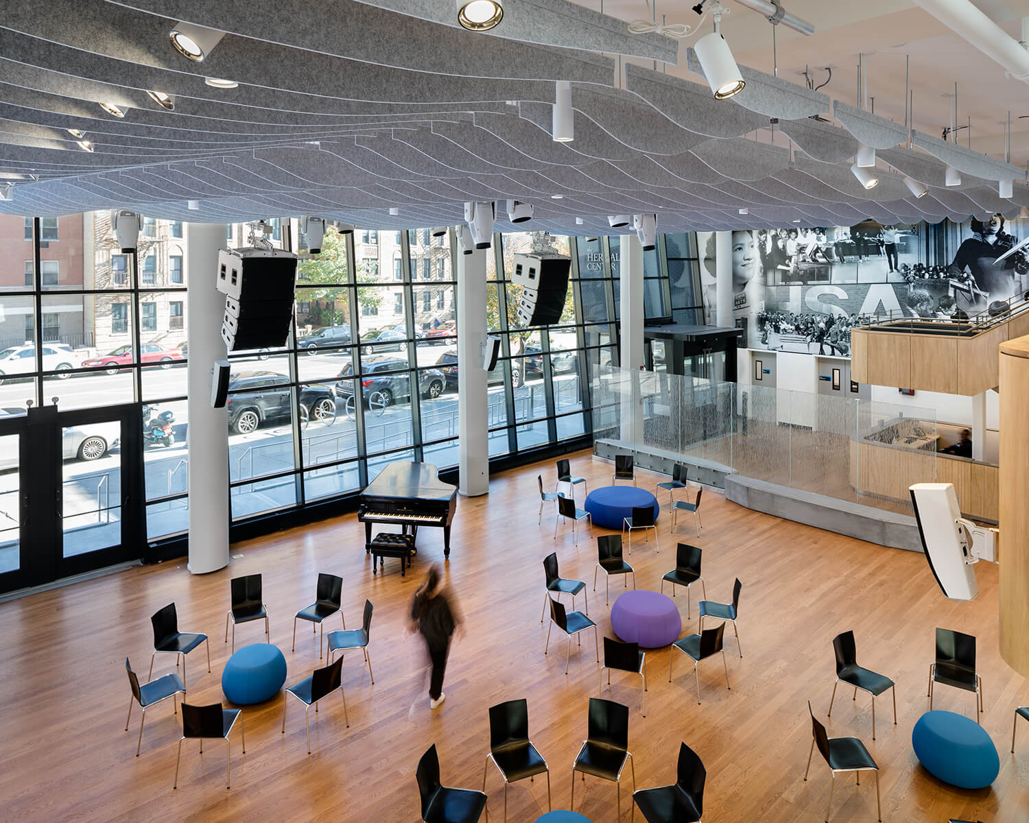 View of the building's atrium, showing the building's open concept seating space and the glass facade from the interior