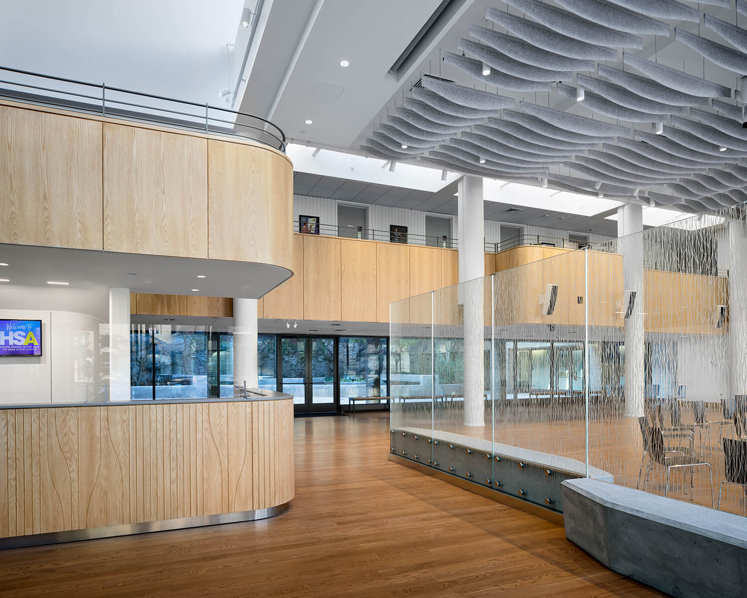 View of the building's atrium, showing the wood-clad security desk.