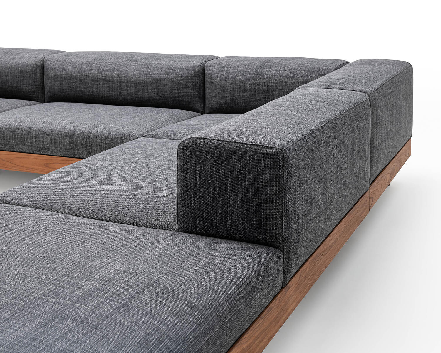 Close-up view of Kasbah modular sectional chaise in grey fabric