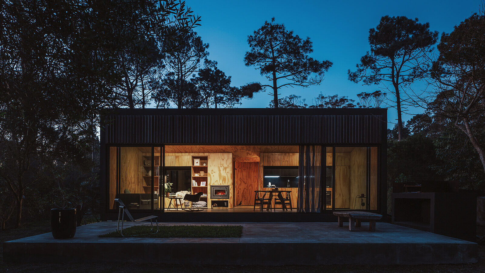 View of the cabin at night, showing the wood-clad interior