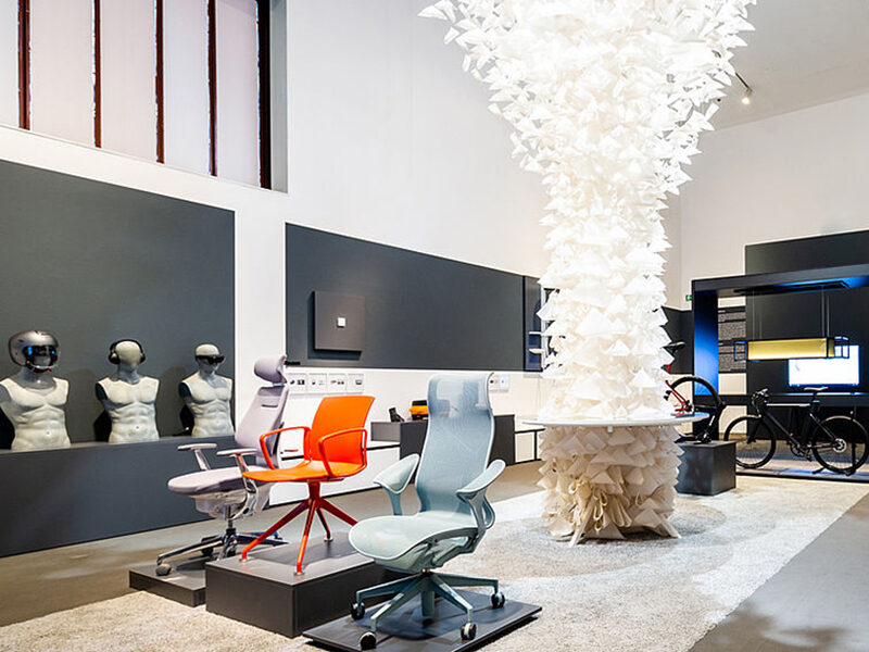 Inside the Milestones in Contemporary Design exhibit, showing chairs on display