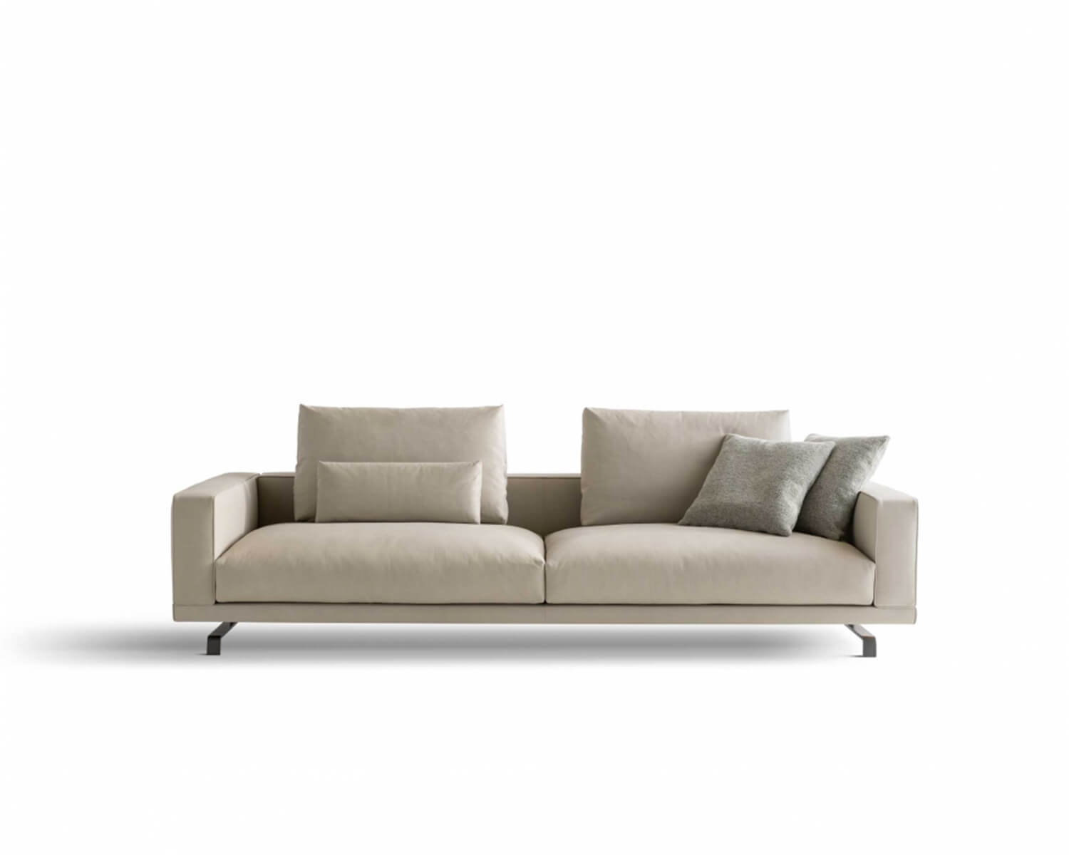 Beige Octave two-seater sofa with neutral coloured throw pillows on a white background