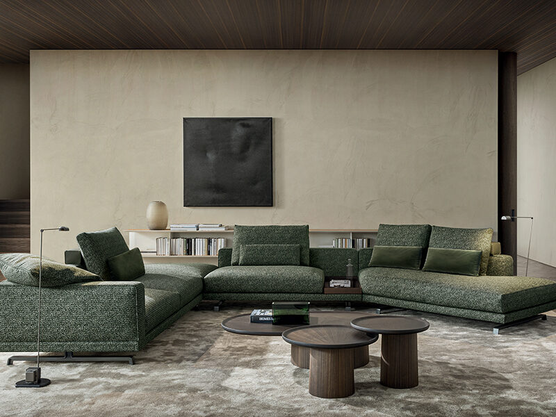 Green Octave sectional sofa in front of beige wall