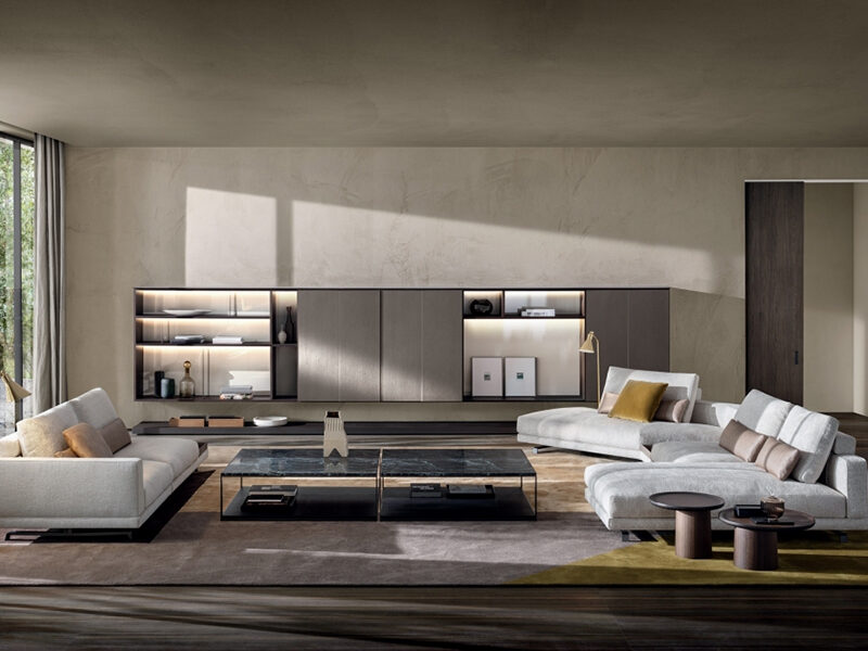 Beige Octave sofa and sectional on brown rug in front of light brown storage unit