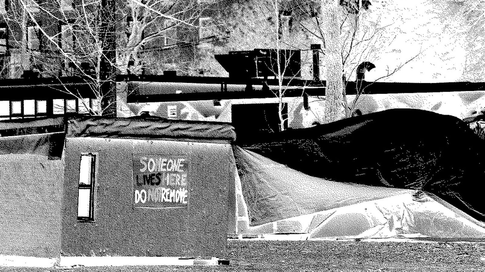 Tent and temporary shelter, with the words: Someone Lives Here Do Not Move written on the side