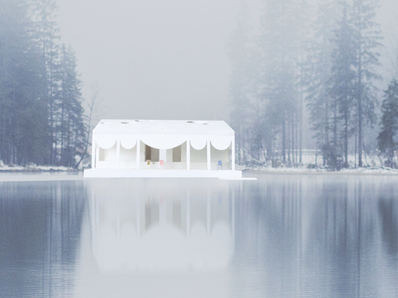 White silhouette of a house on a lakefront between trees