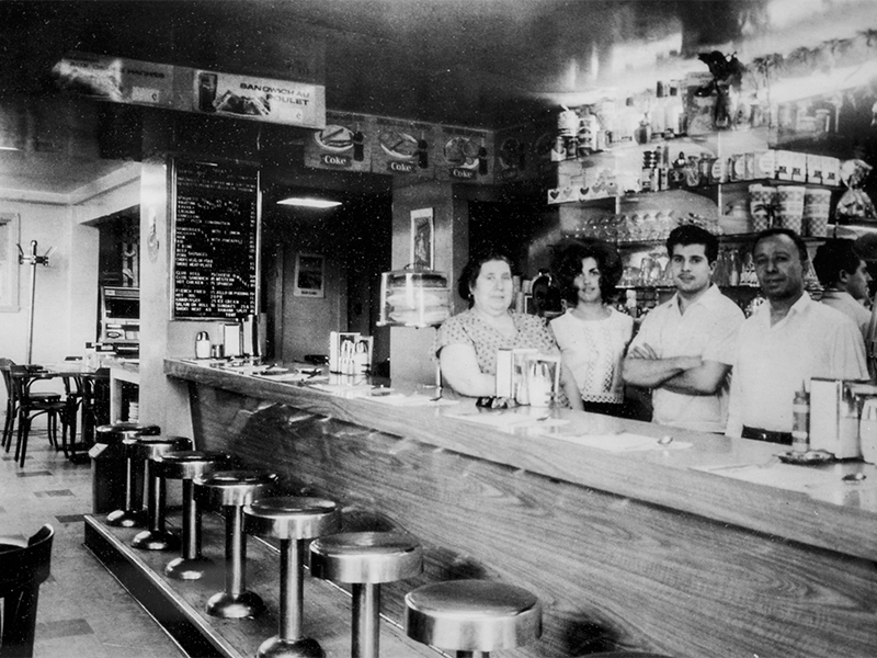 Black and white image of the bar at Cafe Gentile's flagship location