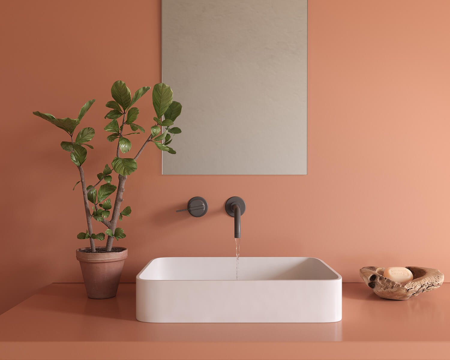 Red Silestone countertop with white sink and black faucet, with plant in a terracotta pot