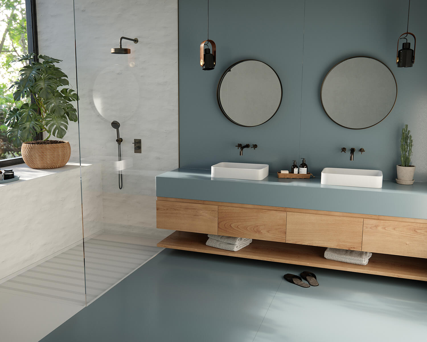 Bathroom with blue walls, floor, and countertop with white tiled shower and two circular mirrors above the vanity
