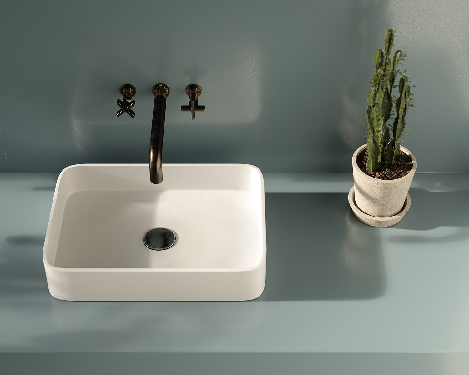 Blue Silestone countertop with white sink with black faucet and plant in a white pot