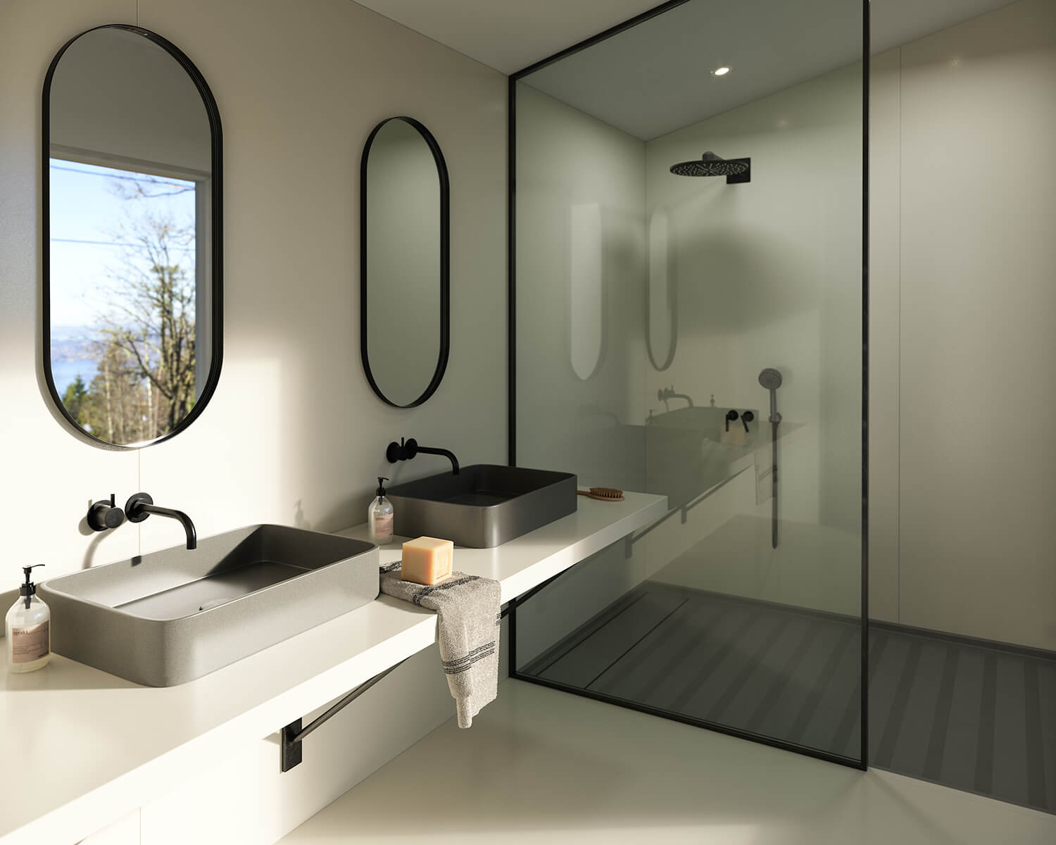 Bathroom with white Silestone counter, two grey sinks with black oval mirrors above