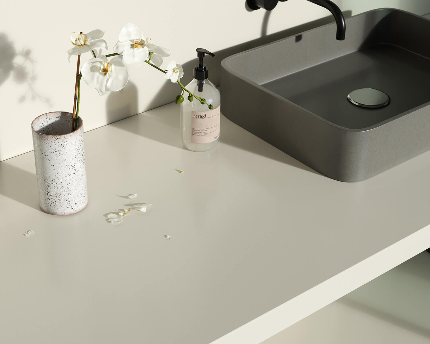 White Silestone countertop with grey sink and white flower in a white vase