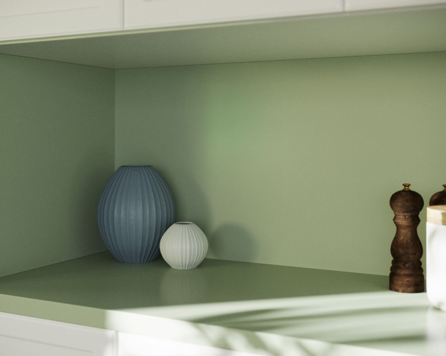 Green Silestone shelf with salt and pepper grinders and blue and white vases