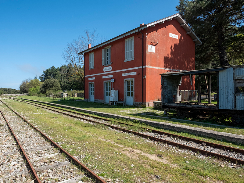 Red building next to train tracks