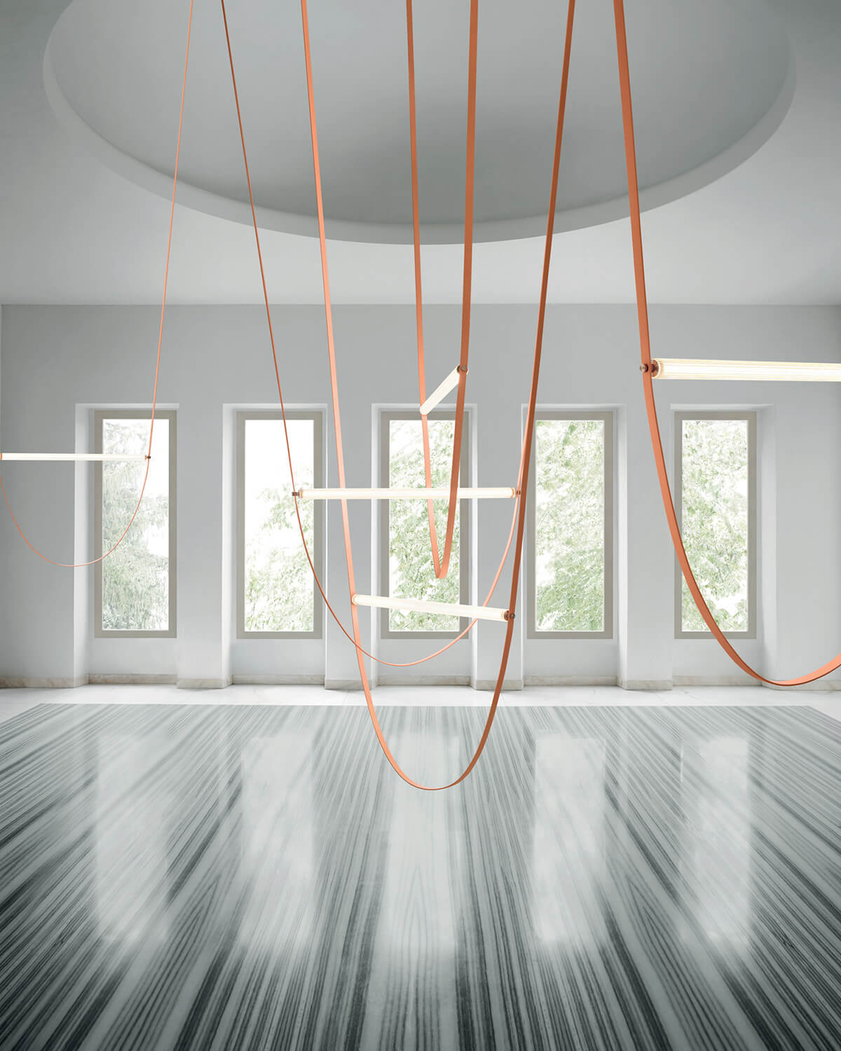 Multiple pink Wireline lights hung from a white vaulted ceiling