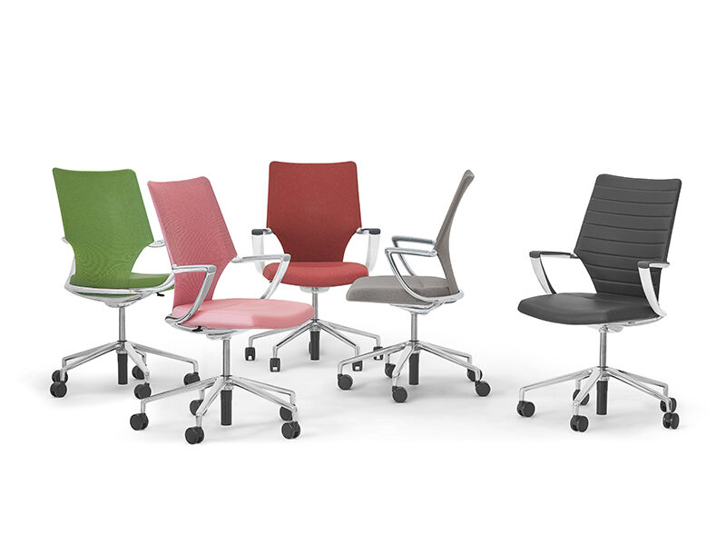 Green, pink, red, grey, and black Swurve chairs on a white background