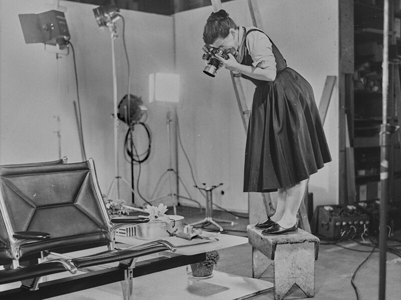 Ray Eames photographing a chair