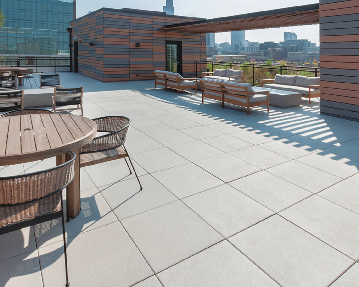 Unilock slabs on a rooftop deck with lounge and dining seating