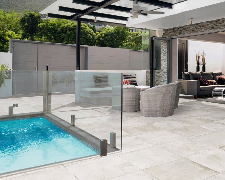 Light grey Unilock slabs on a pool deck