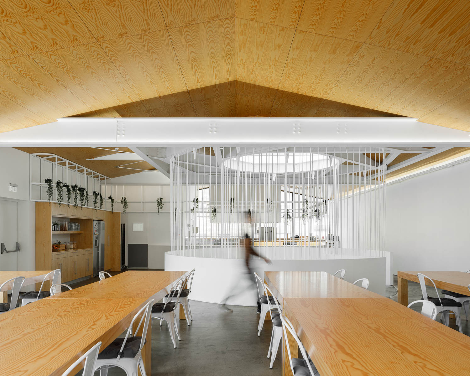 View of dining area with wooden ceiling, wooden tables and white chairs