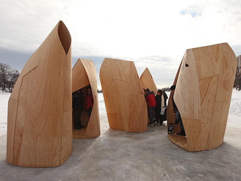 Sculptural wooden warming huts