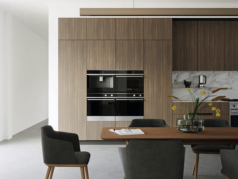 Kitchen with wood cabinetry and integrated Fisher & Paykel oven