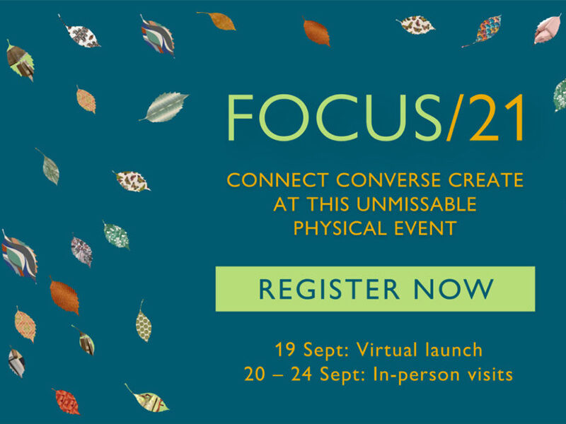 Blue background with patterned leaves. Text reads: Focus/21: Connect, converse, create at this unmissiable physical event
