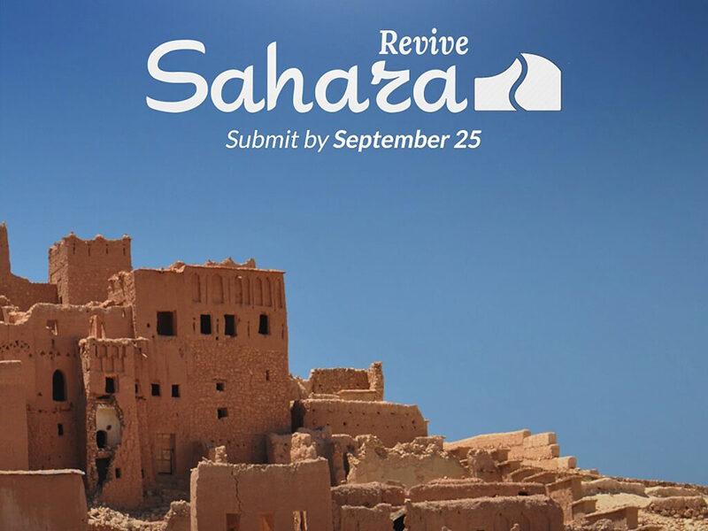 Saharan buildings in front of blue sky. Text reads: Revive Sahara