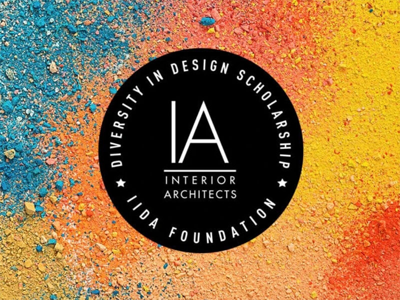 Competition logo on background of coloured pencil shavings