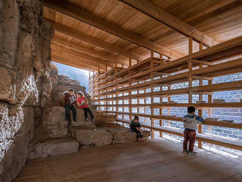 Children sitting in wooden structure