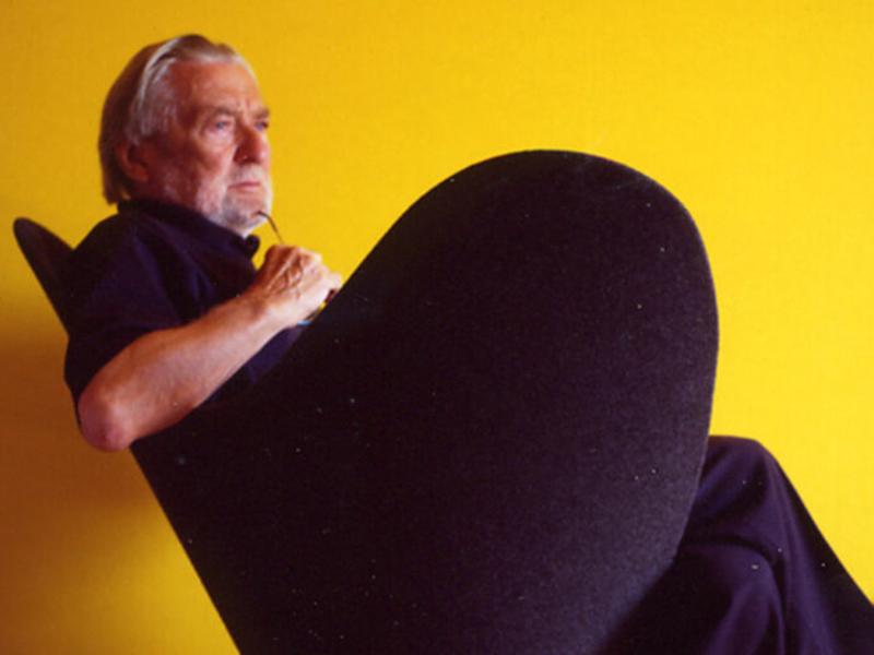 Photo of Verner Panton on yellow background